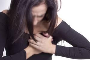 Причины боли в груди во время менструации